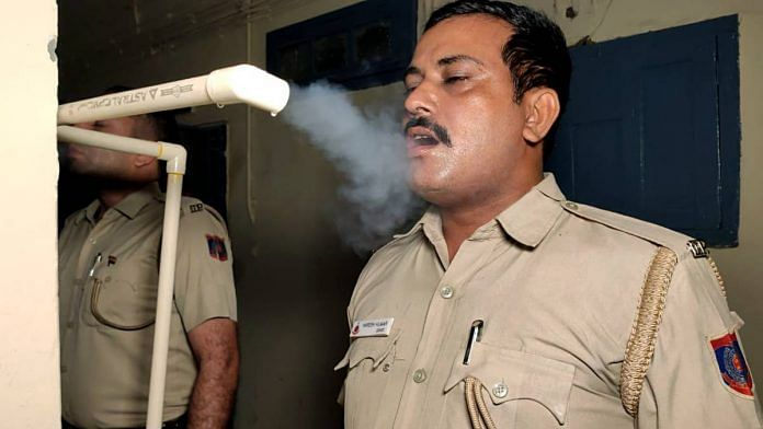 Police officers at a station in Delhi inhale steam | Representational image | ANI