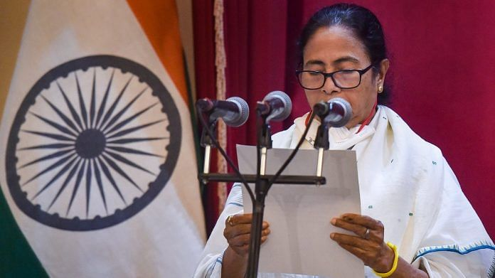 TMC supremo Mamata Banerjee takes oath as the CM of West Bengal for the third time consecutively during her swearing-in-Ceremony at Governor House in Kolkata, on 5 May 2021   PTI