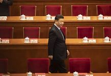 Xi Jinping attends the closing of the Second Session of the 13th National People's Congress at the Great Hall of the People in Beijing | Photographer: Qilai Shen | Bloomberg