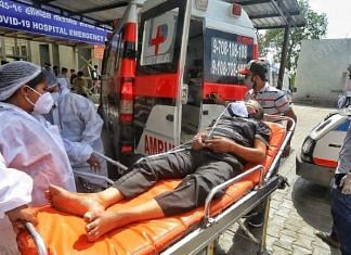 A Covid patient being taken in an ambulance in Ahmedabad, Gujarat | Praveen Jain | ThePrint