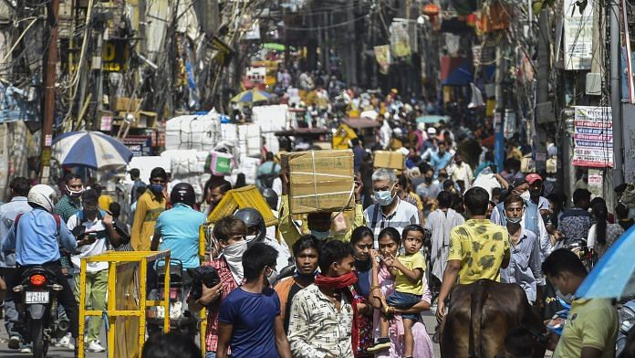 Crowd at Sadar Bazar market after authorities eased Covid-induced restrictions in New Delhi, 14 June 2021   PTI