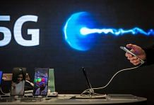 A customer browses a smartphone device in front of a 5G logo inside the Movistar center, in Barcelona, Spain, in January 2021 | Angel Garcia | Bloomberg