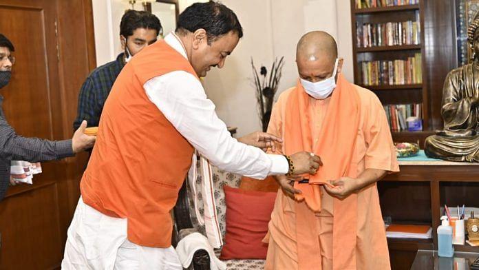 UP Chief Minister Yogi Adityanath with Deputy CM Keshav Prasad Maurya at the latter's Lucknow residence Tuesday | Twitter | @kpmaurya1