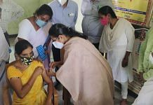 A woman gets her Covid vaccine shot at a vaccination centre in Narpala village in Ananthapur district of Andhra Pradesh on 20 June 2021 | Photo: Twitter/@ArogyaAndhra