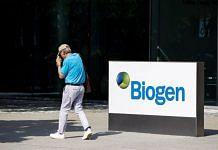 A pedestrian walks past Biogen Inc. headquarters in Cambridge, Massachusetts, US on 7 June 2021 | Bloomberg
