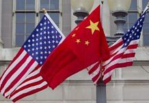 Flags of the US and China fly along Pennsylvania Avenue in Washington (file photo) | D.C Andrew Harrer | Bloomberg