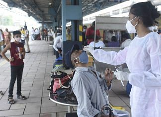 Representative Image   A BMC health worker collects swab sample of a passenger for Covid testing, at Dadar railway station in Mumbai on 22 June   PTI