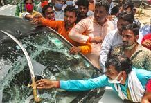 BJP workers show a sword on a damaged vehicle after clash with farmers protesting at Ghazipur border in New Delhi on 30 June 2021 |Photo: PTI