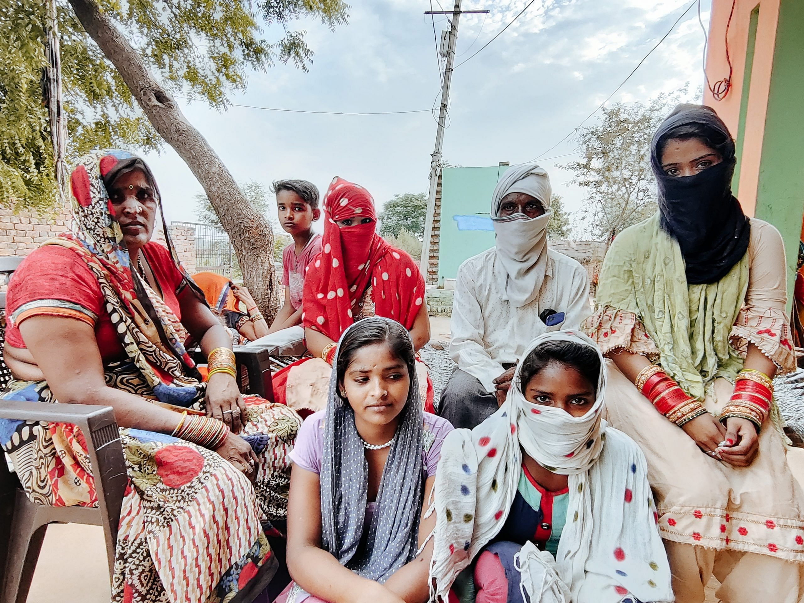 Omprakash with his daughters Sonam and Sapna and the rest of the family at his house in Noorpur | Photo: Shubhangi Misra | ThePrint