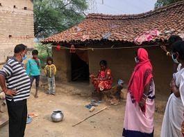 A local seeking to convince Mahadalits in Amarpur tola to take Covid-19 vaccination. | Photo: Jyoti Yadav/ThePrint