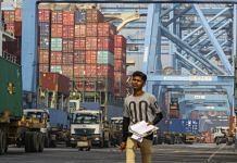 Shipping containers loaded onto trucks at the Jawaharlal Nehru Port, in Navi Mumbai | Photographer: Dhiraj Singh | Bloomberg