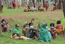 Tribal women sit under the Sal wood trees with their lunch boxes   Photo: Manisha Mondal   ThePrint