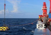 An ocean bottom seismometer (OBS) is lifted into the water during an expedition of RV Sonne in 2017, as researchers from AWI, Germany, study the separation of the Indian plate from Antarctica | Photo: Marc Hiller