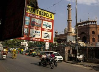 Traffic travels past the Jama Masjid mosque as lockdown restrictions are eased in New Delhi, on 16 June 2021 | Bloomberg