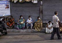 People wait outside a Covid-19 vaccination centre in Kolkata | Photo: Arko Datto | Bloomberg File Photo