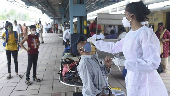 Representative Image | A BMC health worker collects swab sample of a passenger for Covid testing, at Dadar railway station in Mumbai on 22 June | PTI