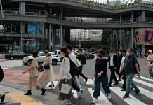 Pedestrians wearing protective face masks cross an intersection passing Miyashita Park in the Shibuya district of Tokyo, on 2 June 2021 | Photographer: Soichiro Koriyama | Bloomberg