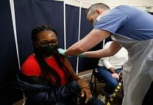 Representational image | A person receives a dose of the AstraZeneca Covid-19 vaccine in Stratford, London | Bloomberg