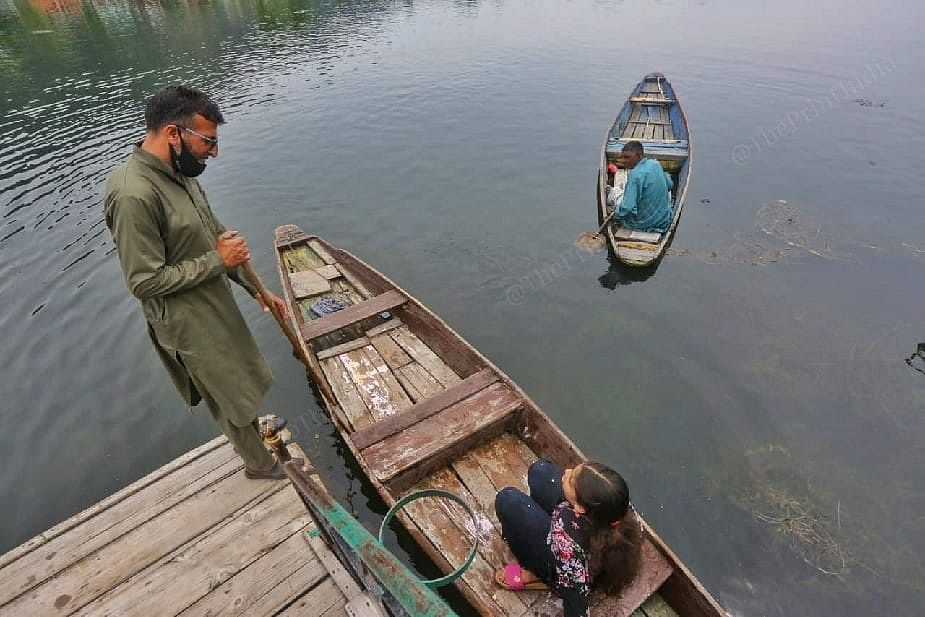 As Jannat leaves for a boat ride, father Ahmad gives her instructions   Photo: Praveen Jain   ThePrint