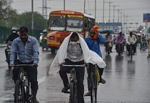 Commuters during rain as monsoon reaches Delhi on 13 July 2021 | PTI