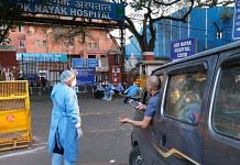 File photo of a health worker assisting an ambulance outside a hospital | Photographer: T. Narayan | Bloomberg
