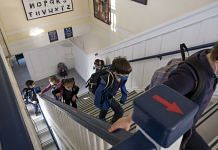 Students wearing protective masks at an elementary school in San Francisco | David Paul Morris | Bloomberg