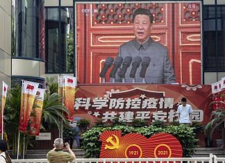 A screen shows a broadcast of Chinese President Xi Jinping speaking at a ceremony marking the centenary of the Chinese Community Party, taking place at Tiananmen Square, in Shanghai | Photo: Qilai Shen | Bloomberg