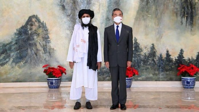 Taliban leader Mullah Abdul Ghani Baradar with Chinese Foreign Minister Wang Yi in Tianjin, China on 28 July 2021 | Twitter/@MFA_China
