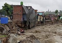 A partially washed away house amid flood water as heavy rain lash after a cloudburst in Dharamshala on 12 July 2021| Photo: PTI