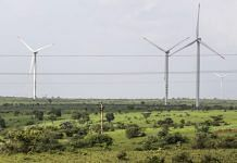 Wind turbines operating beyond electricity cables in Lahori, India |Photographer: Dhiraj Singh/Bloomberg