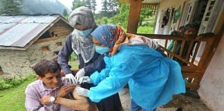 Health workers Abida Quayoom and Shamshada Akhtar vaccinating local residents at the Naranag village, Ganderbal district, in Kashmir   Praveen Jain   The Print