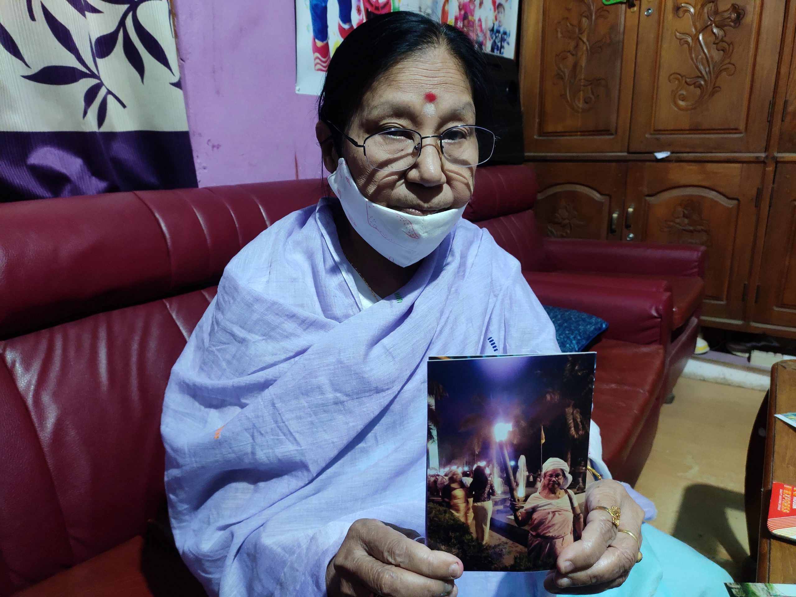 Ima Gyaneshwori holds a picture of herself protesting in the early 2000s   Simrin Sirur   ThePrint