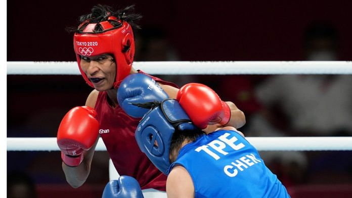 Indias Lovlina Borgohain lands a punch on Chen Nien-Chin of Chinese Taipei during womens welterweight (64-69kg) category boxing match at Tokyo Olympics on 30 July 2021   Photo: PTI