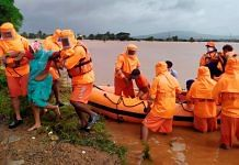 NDRF team during a rescue operation at a fooded area after rain in Kolhapur, on 25 July 2021 | PTI