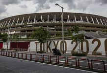 A man drives past the New National Stadium, the main stadium for the Tokyo Olympics, on 3 June 2021 in Tokyo | Photographer: Yuichi Yamazaki/Getty Images via Bloomberg