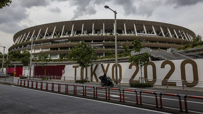 A man drives past the New National Stadium, the main stadium for the Tokyo Olympics, on 3 June 2021 in Tokyo   Photographer: Yuichi Yamazaki/Getty Images via Bloomberg