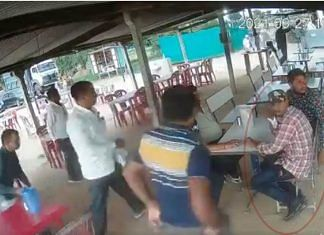A screen grab from the video of a man being arrested by the Ahmedabad police crime branch