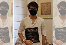 Raihan Vadra, 20, the son of Congress leader Priyanka Gandhi Vadra and businessman Robert Vadra, holds a catalogue for his exhibit 'Dark Perceptions'   Shubhangi Misra   ThePrint