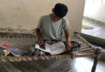 Rohit, a resident of Sehlang village in Mahendragarh district, reads a textbook at home | Jyoti Yadav | ThePrint