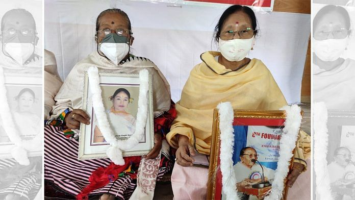Ima Moirangthem Sorojini and Ima Gyaneshwori, who participated in the 2004 protest, hold pictures of two fellow protesters who have passed away since   Simrin Sirur   ThePrint