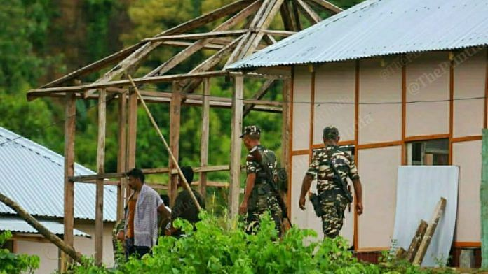 Mizoram Police personnel at the under-construction post (left) that allegedly sparked the clashes   Photo: Praveen Jain/ThePrint