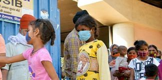 Children in masks at a centre distributing masks and hand sanitizer in New Delhi | Representational image | ANI Photo