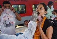 A BMC health worker collects a swab sample of a passenger for the Covid test, at a station in Mumbai, on 30 June 2021 | PTI