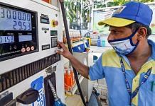 A pump attendant fills petrol in a car at a refilling station in New Delhi, on 15 July 2021 | PTI