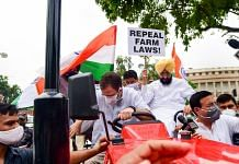 Congress leader Rahul Gandhi on a tractor outside the Parliament, in support of farmers agitation against Centres farm reform laws, in New Delhi Monday, on 26 July 2021 | PTI