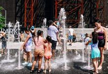 Visitors cool off in the splash pad at Domino Park during a heatwave in the Brooklyn borough of New York, on 29 June 2021 | Nina Westervelt | Bloomberg