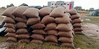 Sacks of paddy crops soaked in the rain at a procurement center, in Tamil Nadu