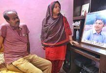 Sachin Chauhan's parents, Suresh and Anita, with his photo   Praveen Jain   ThePrint