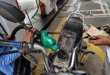 A pump attendant fills petrol in a bike at a fuel station in New Delhi, on 7 July 2021 | PTI