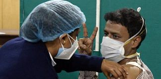 A doctor shows the victory sign as he is vaccinated against Covid-19 in Kolkata | Representational image | ANI
